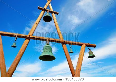 Low angle view of  a wooden construction with bells in front of the house of Pablo Neruda