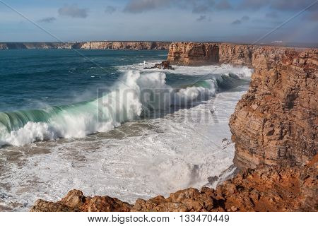 Giant waves hit the rocks. Sagres in Portugal.