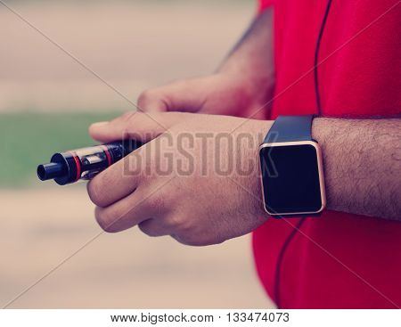 Hands Of Black Man Holding New E-cig Vaporizer Device