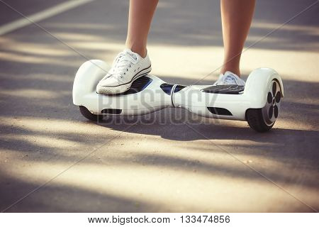 Feet Of Girl Riding Electric Mini Hoverboard Scooter