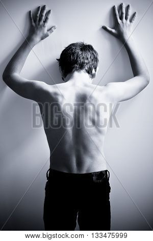 Black And White Back Of Teen With Hands On Wall