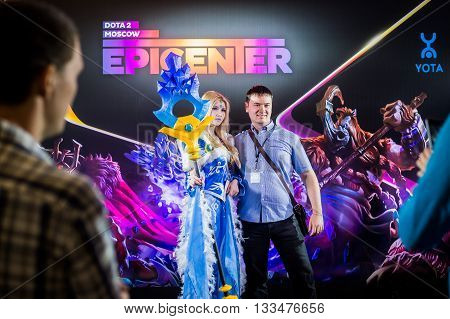 MOSCOW, RUSSIA - MAY 13 2016: EPICENTER MOSCOW Dota 2 cybersport event. Cosplay of game heroes crystal maiden and juggernaut at the event background making photo with visitor