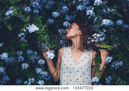 Beauty In Nature. Woman Portrait On Flowers Background