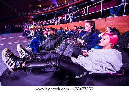 MOSCOW, RUSSIA - MAY 14 2016: EPICENTER MOSCOW Dota 2 cybersport event. Tournament spectators relaxing on the poufs.