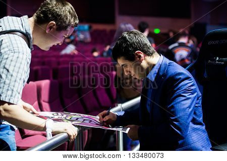 MOSCOW, RUSSIA - MAY 14 2016: EPICENTER MOSCOW Dota 2 cybersport event. Caster Commentator Versuta of the game giving the autograph