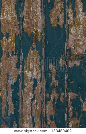 Wooden Door With Flaky Painted Boards