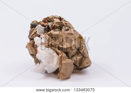 Crumbled paper wadded and crunched into a ball