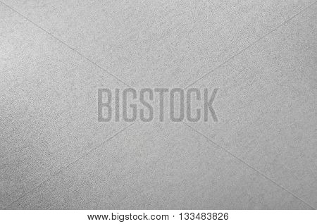 Gray textured stell metallic background close up DOF