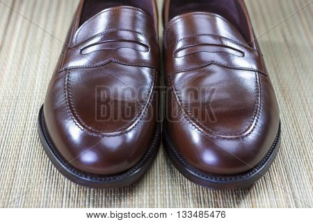 Closeup of Men's Brown Fashionable Penny Loafer's Toe Tips. Front View.Horizontal Shot
