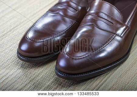 Footwear Concept and Ideas. Men's Stylish Brown Penny Loafers Toe Tips Closeup. Horizontal Shot