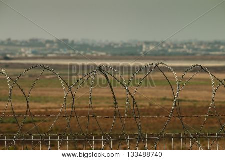 Security fence at Israeli border with Gaza City in the background