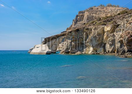 Arched rock formation at Gerontas beach on the south of Melos island in Greece.