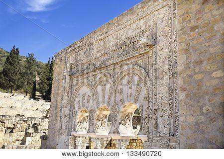 MEDINA AZAHARA, SPAIN - September  11, 2015: Detail of the facade of the House of Yafar at Medina Azahara medieval palace-city near Cordoba on September  11, 2015 in Medina Azahara, Spain