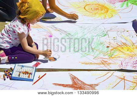 Istanbul Turkey - June 9 2013: In protest area under the supervision of their parents children who work in paint. A wave of demonstrations and civil unrest in Turkey began on 28 May 2013 initially to contest the urban development plan for Istanbul's Taksi