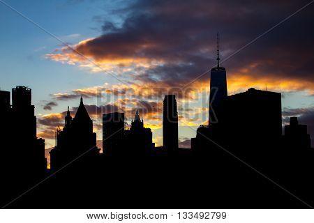 New York City skyline buildings silhouette at sunset in Manhattan