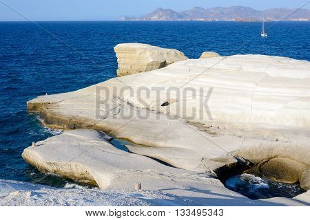 Sarakiniko Melos Greece. Complex shapes and gullies formed by water flowing into the gorge and out to sea between soft white rocks has carved out the stream bed into a moonscape.