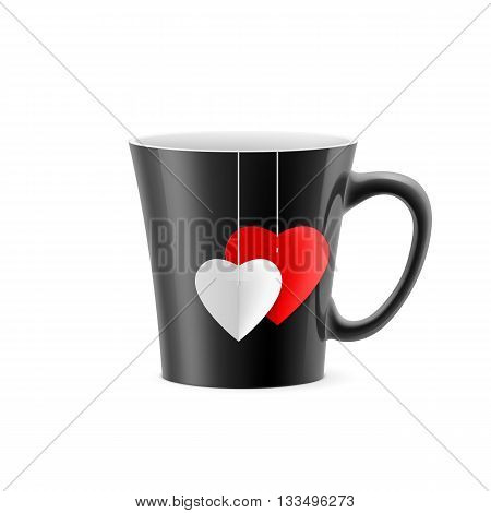 Black cup with tapered bottom with a tea bag in the form of hearts