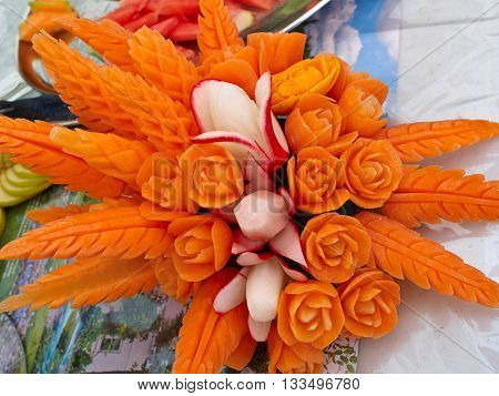 Fruit carving food sculpture art display of selection of carved carrot