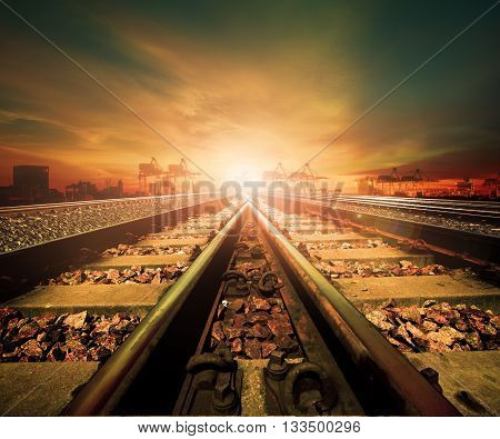 junction of railways track in trains station agains beautiful light of sun set sky use for land transport and logistic industry background backdropcopy space theme