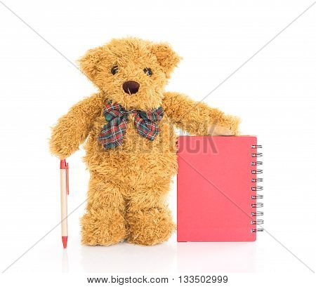 Teddy Bear With Pen On Blank Red Notebook