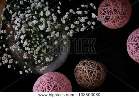 pink entourage balls with a bouquet of flowers