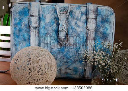 blue suitcase on the table in the entourage