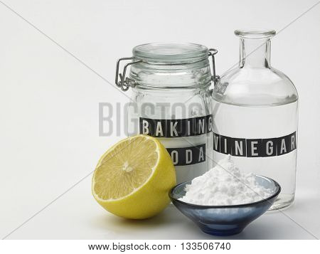 baking soda vinegar and lemon on the white background