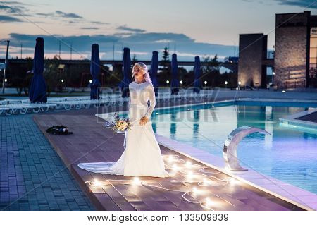 Young Bride In Luxury Wedding Dress. Evening