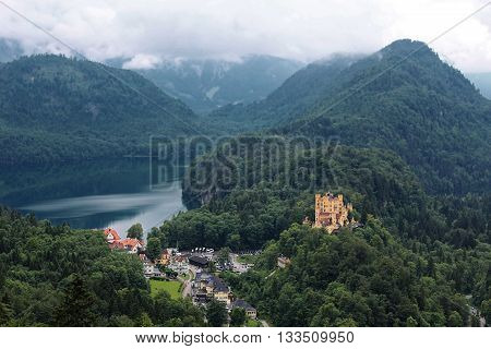 Bavarian Alps landscape, green forests and Hohenschwangau Castle