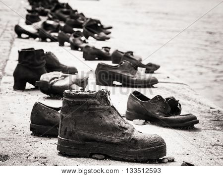 Shoes on the Danube bank is a memorial in Budapest Hungary. Place of reverence. Black and white photo. Cultural heritage. Symbolic object. Shoes monument.