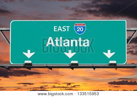 Atlanta Interstate 20 east highway sign with sunrise sky.