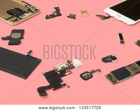 Smart phone components isolate on pink background with copy space