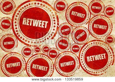retweet, red stamp on a grunge paper texture