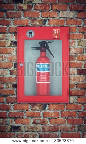 Fire extinguisher in wall box. brick wall background