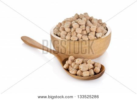 garbanzo beans in wooden bowl and spoon on white background