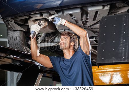 Mechanic Fixing Underneath Car