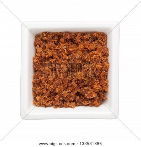 Spicy dried shrimp sambal in a square bowl isolated on white background