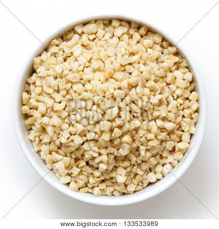 Bowl Of Peeled Chopped Almonds Isolated On White From Above.