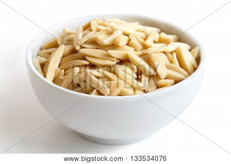 White Bowl Of Peeled Slivered Almonds Isolated On White.