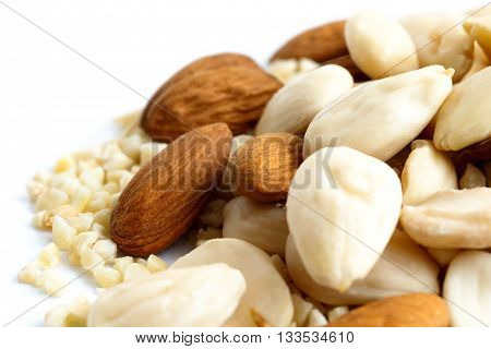 Detail Of Whole, Chopped And Blanched Almonds Mixed Together.