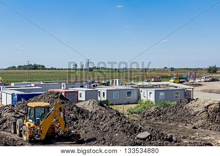 Administration settlement made of container office at building site.