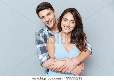 Happy loving couple isolated isolated on gray background