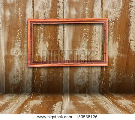 Blank Frame on Vintage Wood Background .
