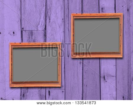 Blank Frame on Vintage Wood Background .