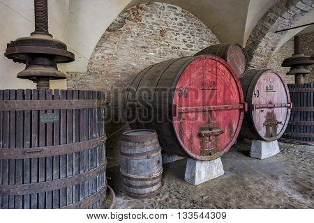 Monastero, Italy - May 28, 2016: Wine barrel and winepress in Monastero Bormida in Piedmont Italy