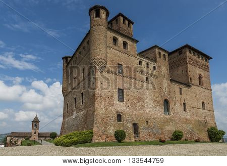 Grinzane Cavour Italy - May 30 2016: Wine Castle Grinzane Cavour and Church in Piedmont in Barolo district in Italy.