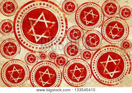Star of david, red stamp on a grunge paper texture