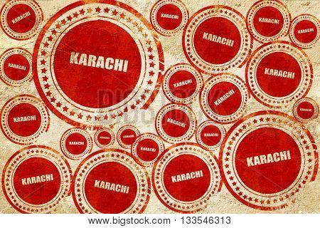 karachi, red stamp on a grunge paper texture