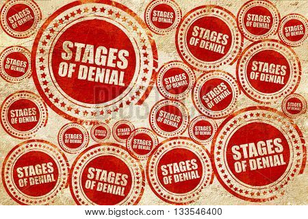 stages of denial, red stamp on a grunge paper texture