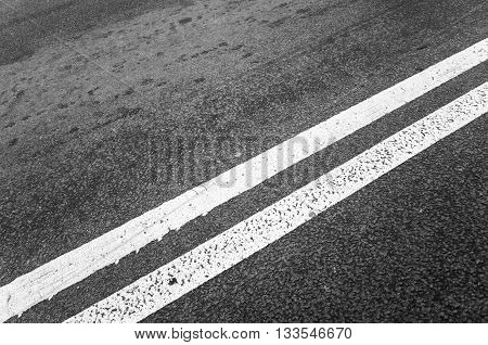 White Double Dividing Line Over Black Highway